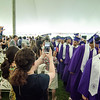Proud members of the audience snap photos as the graduates enter the 141st commencement ceremony at Cushing Academy in Ashburnham on Saturday morning. SENTINEL & ENTERPRISE / Ashley Green