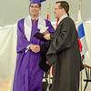 Pablo Santiago Arencibia Alvarez receives his diploma from Headmaster Chrostopher Torino during the 141st commencement ceremony at Cushing Academy in Ashburnham on Saturday morning. SENTINEL & ENTERPRISE / Ashley Green