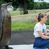 Breton Lorway, 16, talks about the penguin statue she was a part of creating as a student at Cushing Academy in Ashburnham. SENTINEL & ENTERPRISE / Ashley Green