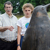Art Director Bob Johnson, along with Breton Lorway, 16, talks about the penguin statue she was a part of creating as a student at Cushing Academy in Ashburnham. SENTINEL & ENTERPRISE / Ashley Green