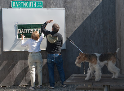 Janet and George hang a Dartmouth banner, with supervision.