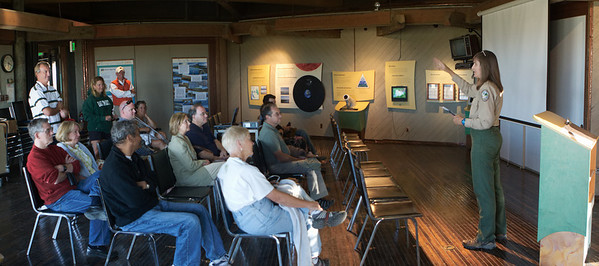 The group of attendees discussed the history of the baylands salt marsh area.  People trickled in during the presentation preceding the tour.