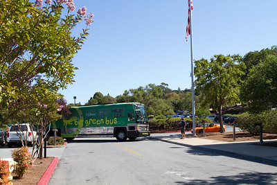 The Big Green Bus pulls into the Tesla parking lot.