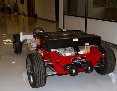 The internal parts of the Roadster, including the battery pack and motor, are visible in this partial vehicle on display just for the Dartmouth audience.