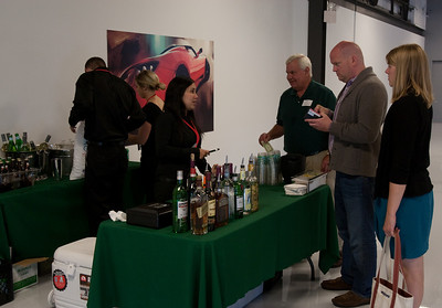 """Tonic Beverage Catering provided beverage catering to all Dartmouth attendees.  Roger Brett '66, David Liddle, and DAASV Vice-President Whitney Flynn '07 are official """"taste testers""""."""