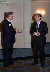 President Jim Yong Kim '82a and DAASV President James von Rittmann '95 discuss the upcoming Dartmouth Golf Tournament at Pebble Beach.