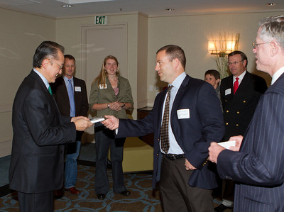 James Knopf '89 presents President Kim with an iPod Touch containing the iDAASV app.