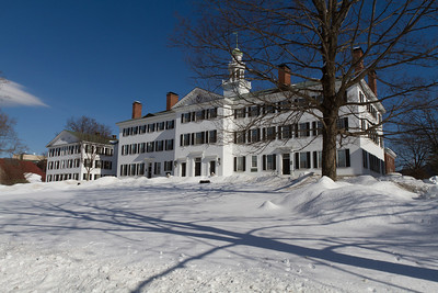 Dartmouth Hall atop the snow covered hill.