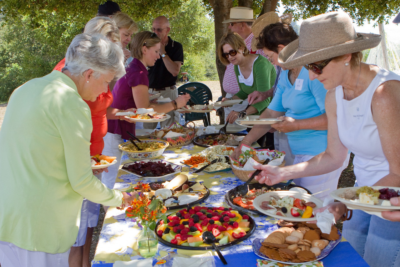 Having worked up an appetite with sparkling wine greeting and a hike up the hill, everyone enthusiastically dug into the luscious lunch provided.