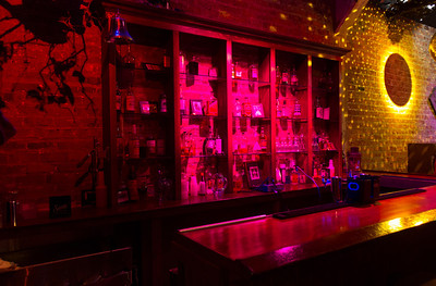 Lighting is very important in the production spaces.  Here the real and created bottles at a touch of realism to this functional bar.  The mirrored globe was in place for a party held the prior week.