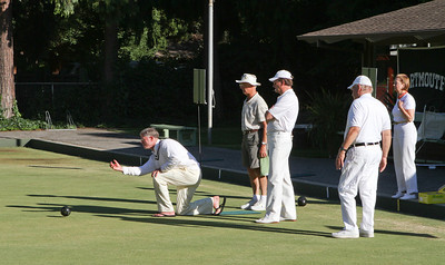 DAASV President, James von Rittmann '95, leading by example, tries out the bowling.  Looking on are Alan Gaynor '67, Jeff Brown '66 P'97, Janet Kluczynski '77 and John Hickson.