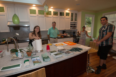 Our hosts getting ready for guests.  Dartmouth Alumni Relations provided some materials for the parents and students about Dartmouth College.  Linda and her family hosted the event.