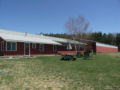 The main barn, tack room, office, stables for Dartmouth horses, and indoor riding arena.