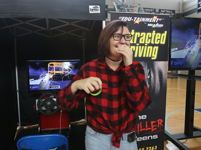 Safe A Life Tour visits Nashoba Tech to demonstrate to students the danger of distracted driving and texting and driving. Chloe Sherwood, 16, of Pepperell, reacts after crashing in the simulation. (SUN/Julia Malakie)