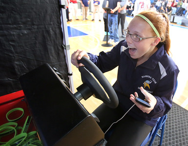 Safe A Life Tour visits Nashoba Tech to demonstrate to students the danger of distracted driving and texting and driving. Madison Repoza, 16, of Chelmsford, reacts to driving in the simulation. (SUN/Julia Malakie)