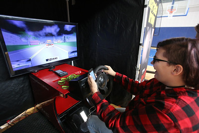Safe A Life Tour visits Nashoba Tech to demonstrate to students the danger of distracted driving and texting and driving. Chloe Sherwood, 16, of Pepperell, drives in the simulation. (SUN/Julia Malakie)