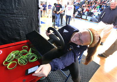 """Safe A Life Tour visits Nashoba Tech to demonstrate to students the danger of distracted driving and texting and driving. Madison Repoza, 16, of Chelmsford, says """"I give up"""" after being unable to keep up with texting while driving in the simulation. (SUN/Julia Malakie)"""