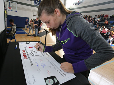 Safe A Life Tour visits Nashoba Tech to demonstrate to students the danger of distracted driving and texting and driving. Kristina Despres, 16, of Shirley signs the pledge after doing the simulation. (SUN/Julia Malakie)
