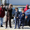 Parents and kids watch from the Lo-Kai restaurant parking lot as Englesby Elementary School teachers hold a parade of 30 cars with signs through their students' neighborhoods, during school shutdown for coronavirus/covid-19 emergency.  (SUN/Julia Malakie)