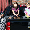 Englesby Elementary School teachers hold a parade of 30 cars with signs through their students' neighborhoods, during school shutdown for coronavirus/covid-19 emergency. Michael Agricourt of Dracut with daughters Juliana Rivard, 10, a 4th grader, and Lilyana Agricourt, 6, a 1st grader.  (SUN/Julia Malakie)