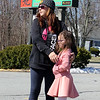 Englesby Elementary School teachers hold a parade of 30 cars with signs through their students' neighborhoods, during school shutdown for coronavirus/covid-19 emergency. Melissa Brown and daughter Makayla Brown, 8, a 2nd grader, wait for the parade. (SUN/Julia Malakie)