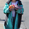 Englesby Elementary School teachers hold a parade of 30 cars with signs through their students' neighborhoods, during school shutdown for coronavirus/covid-19 emergency. Mya Vazquez, 5, a kindergarten student, waits for the parade with her Crybaby, and wearing her mother's jacket. (SUN/Julia Malakie)