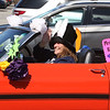 """Englesby Elementary School teachers hold a parade of 30 cars with signs through their students' neighborhoods, during school shutdown for coronavirus/covid-19 emergency. Special Ed teacher Karen Mercurio in her 1970 Mustang convertible. She said """"I got it out special for today. It's been stored all winter."""" (SUN/Julia Malakie)"""