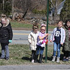 Englesby Elementary School teachers hold a parade of 30 cars with signs through their students' neighborhoods, during school shutdown for coronavirus/covid-19 emergency. From left, 1st grader Mallorie De Lacoste, her sisters, 2nd grader Callie De Lacoste and kindergarten student  Rylie De Lacoste, kindergarten student Hailey Shupe and her sister, 2nd grader Sydney Shupe, 2nd grader Rylee Garcia and her sister, 4th grader Makayla Garcia, watch the teachers leave the Dillon-McAnespie parking lot where the parade ended. (SUN/Julia Malakie)
