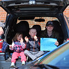 Englesby Elementary School teachers hold a parade of 30 cars with signs through their students' neighborhoods, during school shutdown for coronavirus/covid-19 emergency.  Kim Sheehan of Dracut with son Garrett Quinlan, 6, a kindergarten student at Englesby, and daughter Avery, 3.  (SUN/Julia Malakie)