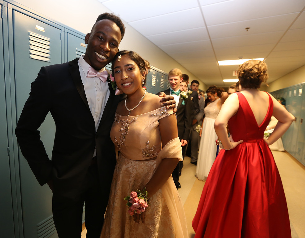 . Pre-prom procession at Dracut High School. Jovan Aigbekaen and Nidhi Patel. (SUN/Julia Malakie)