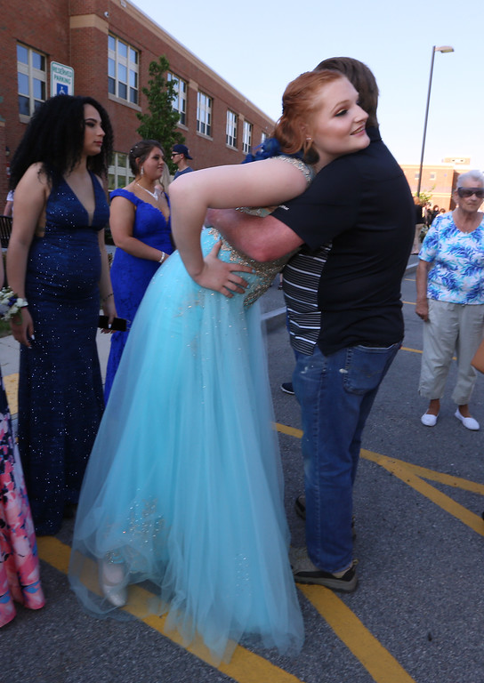 . Pre-prom procession at Dracut High School. Meaghan Garboski hugs her grandfather Paul Nash of Dracut before leaving for the prom. (SUN/Julia Malakie)