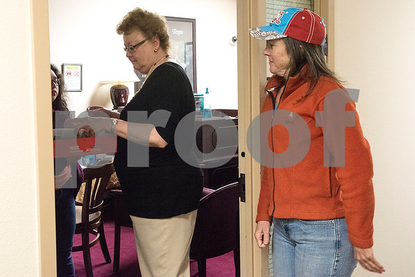 Emily Pinal, left, watches as a woman, center, who works at Congressman Louie Gohmert's office looks at signed petitions as Staci Smith, right, stands outside the office upon request of the woman in Tyler, Texas, on Tuesday, Jan. 9, 2018. The constituents dropped off hundreds of signed petitions for a clean DREAM act. (Chelsea Purgahn/Tyler Morning Telegraph)