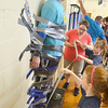 Mike McMahon - The Record , principal of the school, Joe Slichko, challenged the students to raise $10,000 and if they raised the money he would allow the kids to duct tape him to the gymnasium wall and spray him with silly string,  Wednesday June 18, 2014