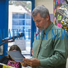 Principal Rodney Symonds reads one of the diplomas before presenting it to a student. Fran Ruchalski/Palatka Daily News