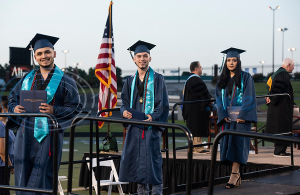 Early College High School graduates exit the stage, diplomas in hand, during their commencement ceremony held at Christus Trinity Mother Frances Rose Stadium on Thursday, June 4, 2020.