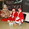 Mr. and Mrs. Claus wait for children to visit with them - ontario early years centre in moosonee, christmas party 2007 december 20