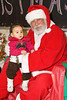 Raven Iserhoff (9 months old) with Santa Claus at the ontario early years centre in moosonee, christmas party 2007 december 20