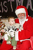 Josh Hergott-Dumoulin (aged one year) with Santa Claus at ontario early years centre in moosonee, christmas party 2007 december 20