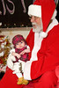 Two month old Kaisha Lougheed held by Santa - ontario early years centre in moosonee, christmas party 2007 december 20