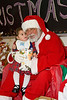 Keira Morrison-Sutherland aged 18 months with Santa - ontario early years centre in moosonee, christmas party 2007 december 20