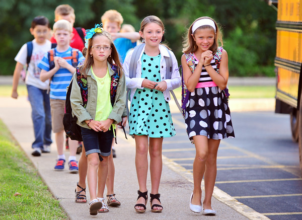 Students make their way to the entrance after getting off the bus for their first day of school at Grant Line Elementary in New Albany Thursday morning.  Staff photo by Tyler Stewart