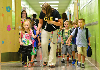 Jennie Hamilton walks with her kindergarten class from the gym as they make their way to the classroom for the first day of school at Grant Line Elementary in New Albany Thursday morning.  Staff photo by Tyler Stewart