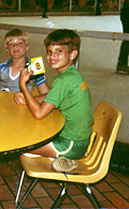 8th Birthday - October 6, 1979 <br /> Plaza Shopping Center Ice Skating Rink, New Orleans, LA<br /> See how clever I was? Holding up the eight card - and it's my eight birthday! Get it? Ahem. It was an ice skating party complete with Uno. Take a good look at those shorts and my name across the back of my shirt!