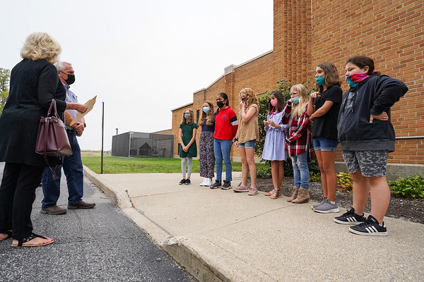 Fifth-grade students talk with Cass Community Community Foundation President Deanna Crispen and Vice Chairman Tim Rich at Pioneer Elementary School in Walton on Tuesday, Sept. 28, 2021.