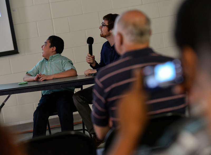Timothy Galdamez and  Julian Murphy look at the screen during their presentation. Kristopher Radder / Reformer Staff