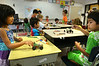 Youngsters work on their toy race cars at engineering camp at Maple Glen Elementary School.    Monday,  July  7, 2014.   Photo by Geoff Patton