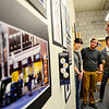 Jerry Beck, director of economic development and chief marketing officer for the city of Fitchburg, looks at projects while Fitchburg State University students (back from left) junior Megan Provencial, 20, of Winchendon, junior Brendan Keohane, 22, of Townsend, and junior Spenser Hasak, 20, of Topsfield talk about their way-finding signs project that would be used to identify locations in Fitchburg and create a brand for the city, Monday during the graphic design students' final critique.<br /> SENTINEL & ENTERPRISE / BRETT CRAWFORD