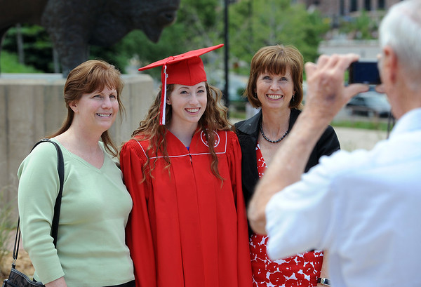 "Linda DeLong, left, graduate Catherine Dean,  and mom, Robin Dean, get their photo taken by grandfather Bill Bishop.<br /> For more photos and a video of Fairview, go to  <a href=""http://www.dailycamera.com"">http://www.dailycamera.com</a>.<br /> Cliff Grassmick / May 20, 2012"