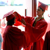 "Rhiannon McKee-Gresham, left, gets help from Taylor Riviera before the Fairview  ceremony.<br /> For more photos and a video of Fairview, go to  <a href=""http://www.dailycamera.com"">http://www.dailycamera.com</a>.<br /> Cliff Grassmick / May 20, 2012"