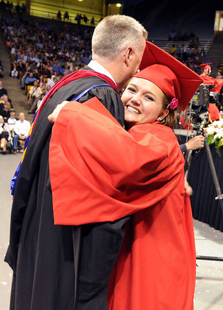 """Fairview Don Stensrud gets a big hug from Melissa Schriener after she gets her diploma.<br /> For more photos and a video of Fairview, go to  <a href=""""http://www.dailycamera.com"""">http://www.dailycamera.com</a>.<br /> Cliff Grassmick / May 20, 2012"""